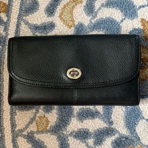 Black leather wallet with Coach checkbook insert